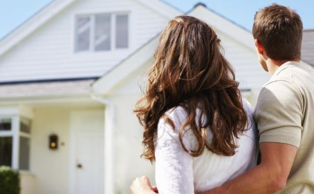 Couple Buying a Repossessed House
