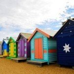 Different colour changing huts on a beach